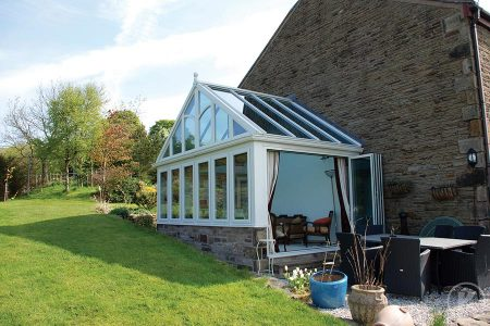 New conservatory with white uPVC roof and brick structure