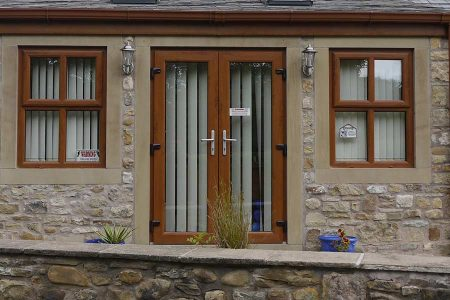 Brown upvc French doors with chrome hardware