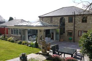 Glass roof extension with double bifold doors