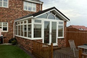 New conservatory roof with warm tiled system