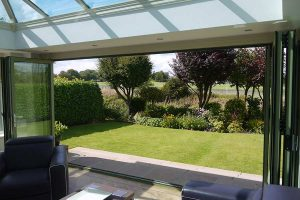 A view out onto the garden from inside an orangery