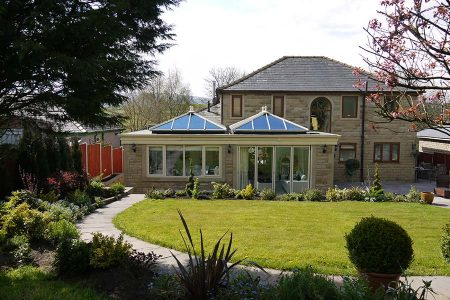 Cream orangery built using a brick structure and upvc lantern style roof