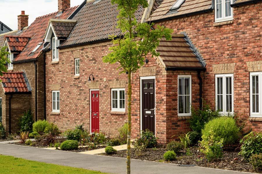 Porch built using brick, composite door, casement windows and tiled roof