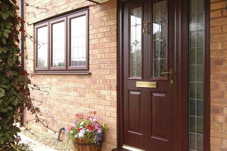 An entrance door with single glass panel in Rosewood brown colour
