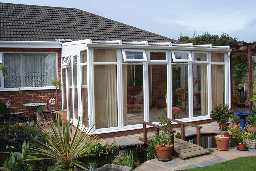 Small lean-to conservatory with upvc windows and doors and roof
