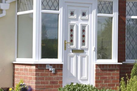 A new uPVC front door in white with decorative glass panels