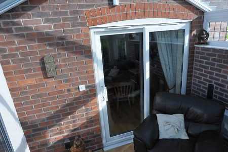 White uPVC sliding patio door with energy efficient glass